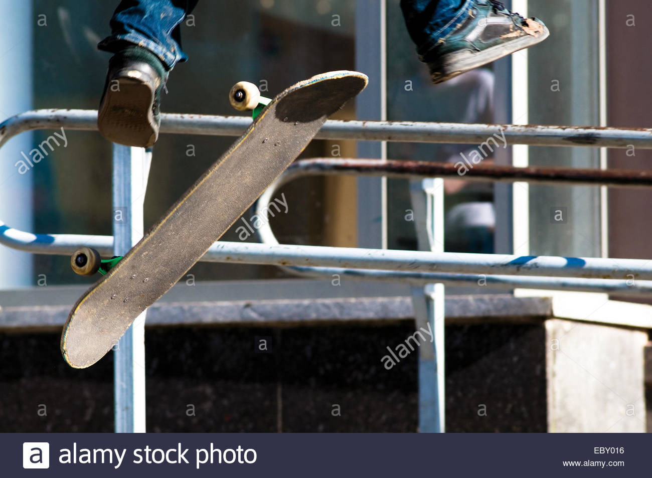 Close up of skate board in the air - Stock Image