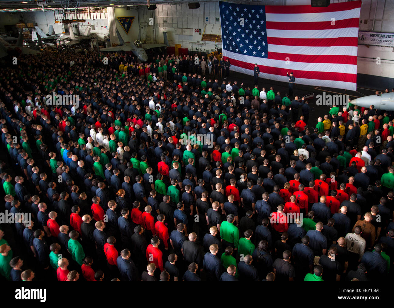 Chief of Naval Operations Adm. Jonathan Greenert address an all hands call in the hanger bay aboard the nuclear - Stock Image