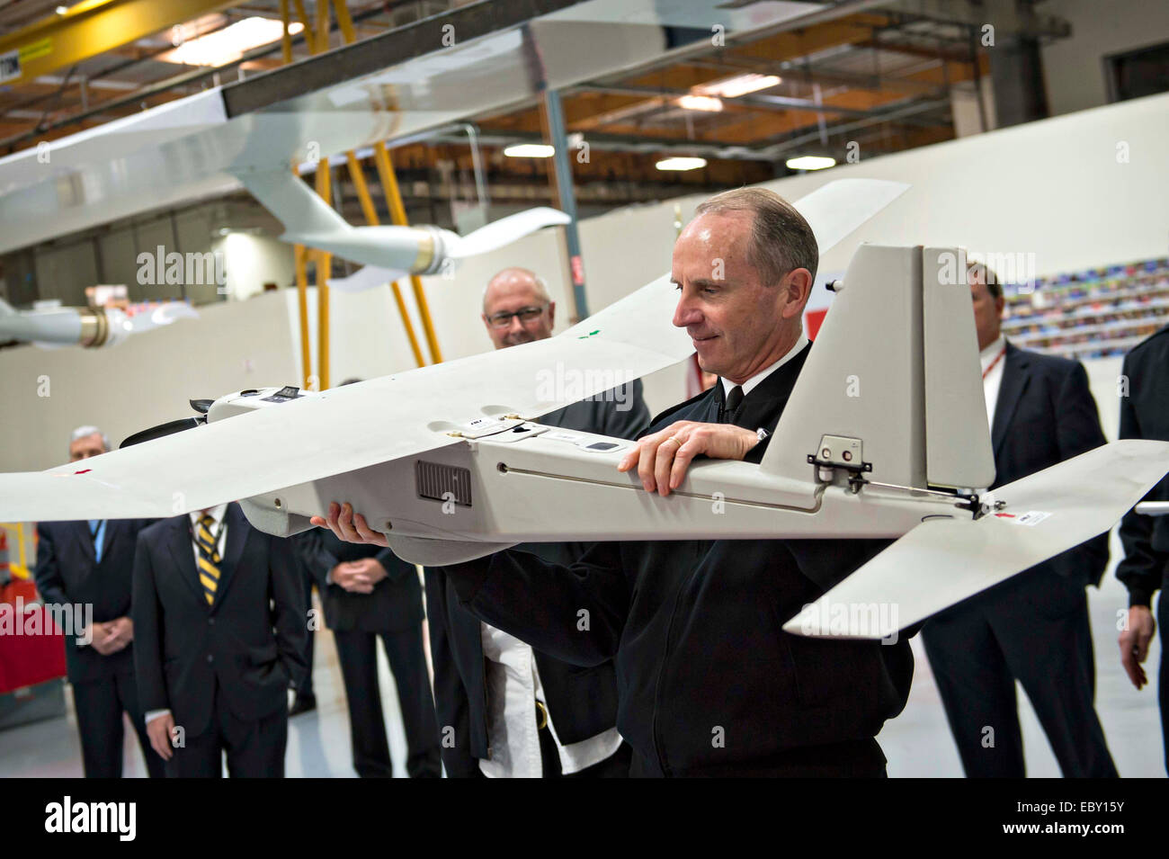 Chief of Naval Operations Adm. Jonathan Greenert holds an unmanned aircraft systems during a visit to AeroVironment - Stock Image