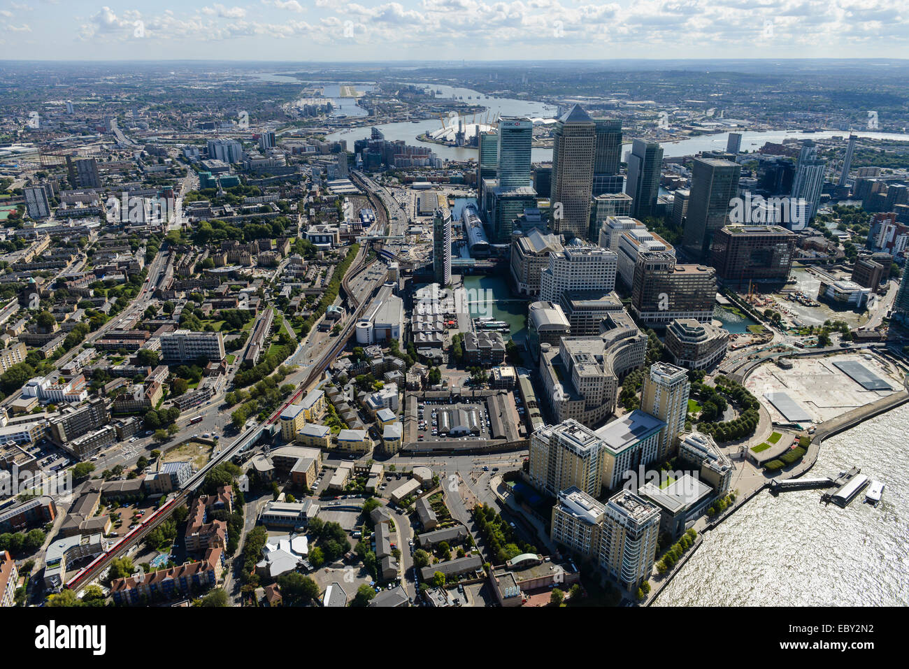 An aerial view of Canary Wharf and surroundings looking east - Stock Image