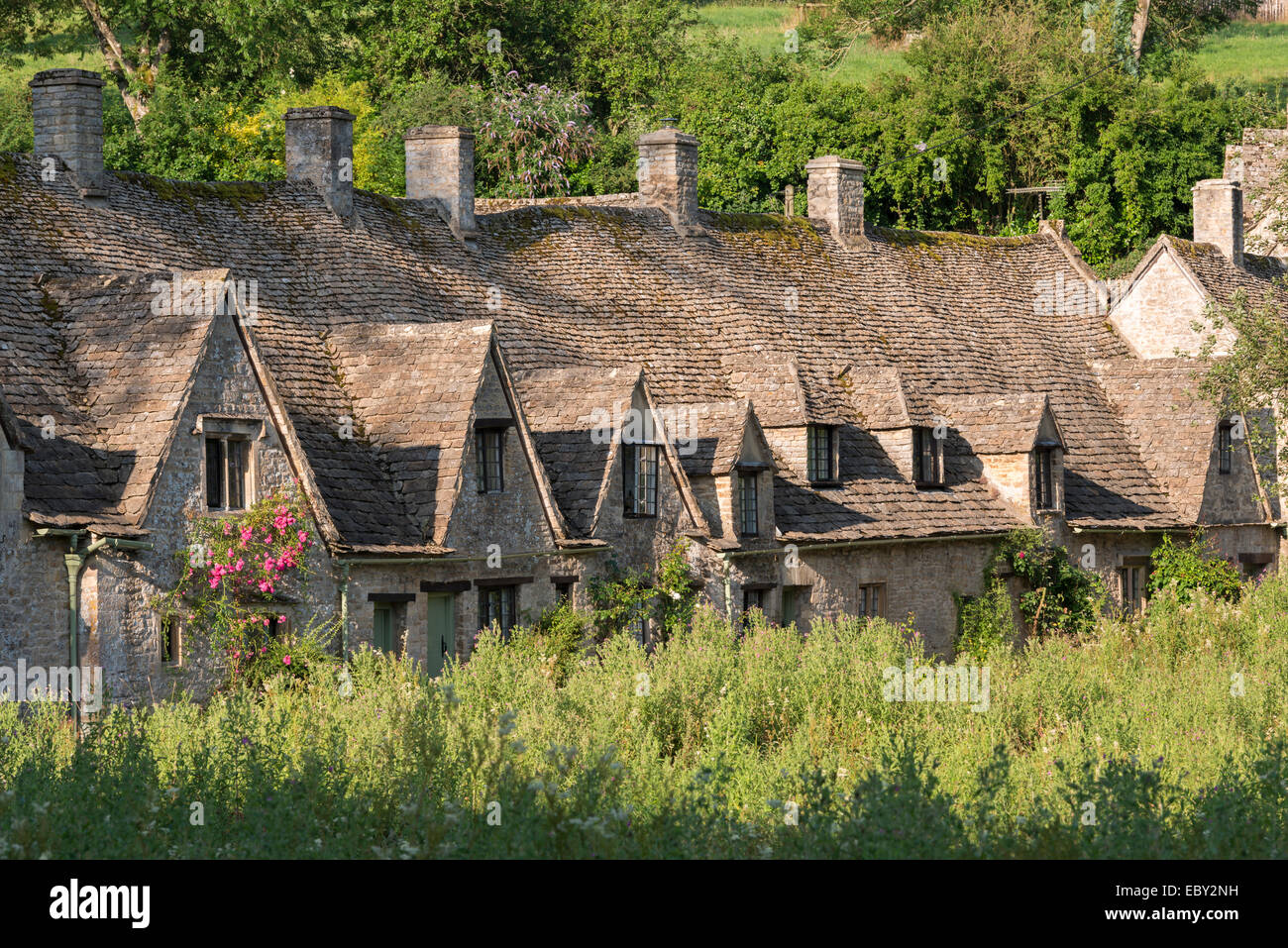Pretty cottages at Arlington Row in the Cotswolds village of Bibury, Gloucestershire, England. Summer (July) 2014. - Stock Image