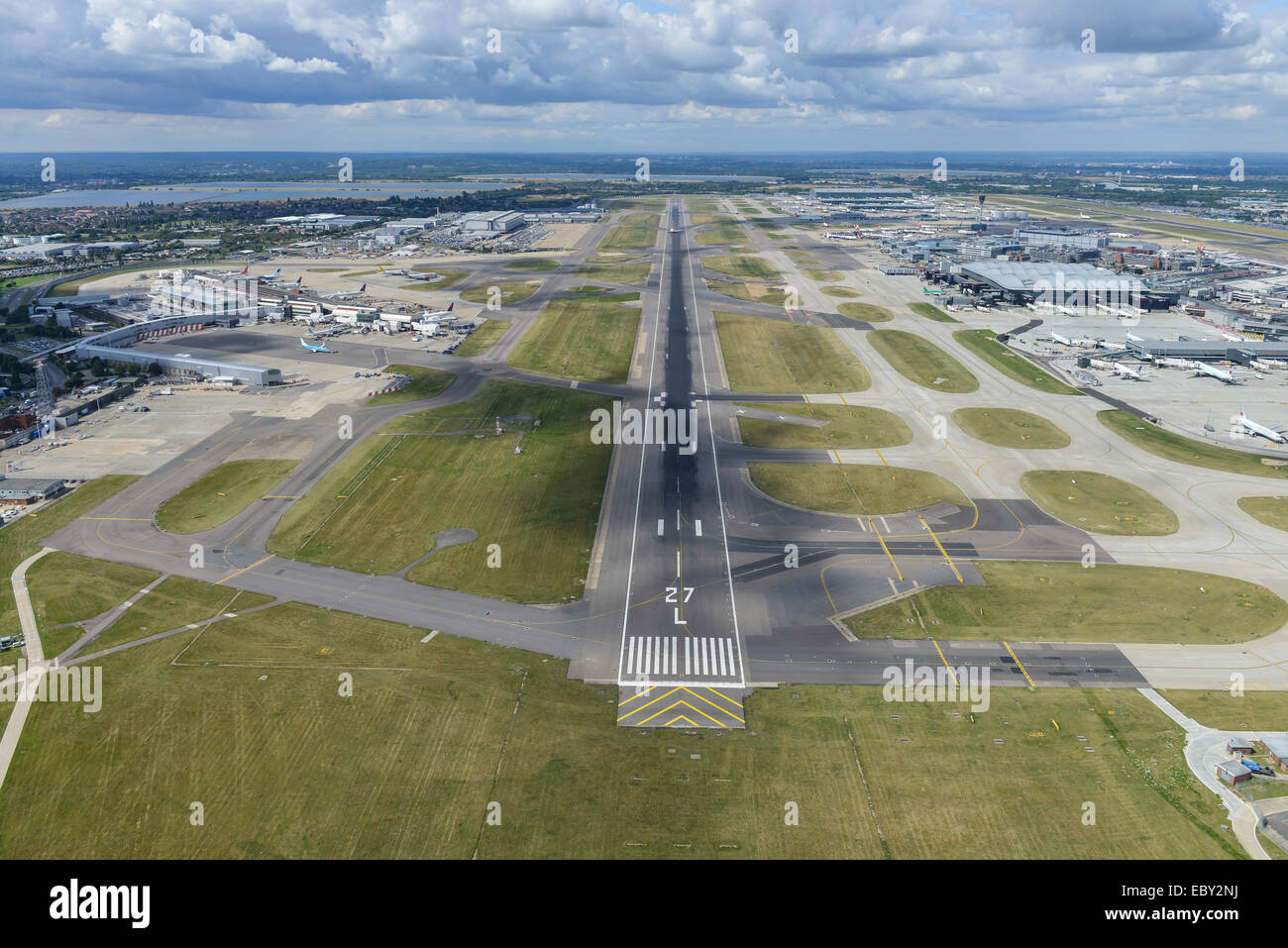 An aerial view looking West down runway 27L at Heathrow Airport, London - Stock Image