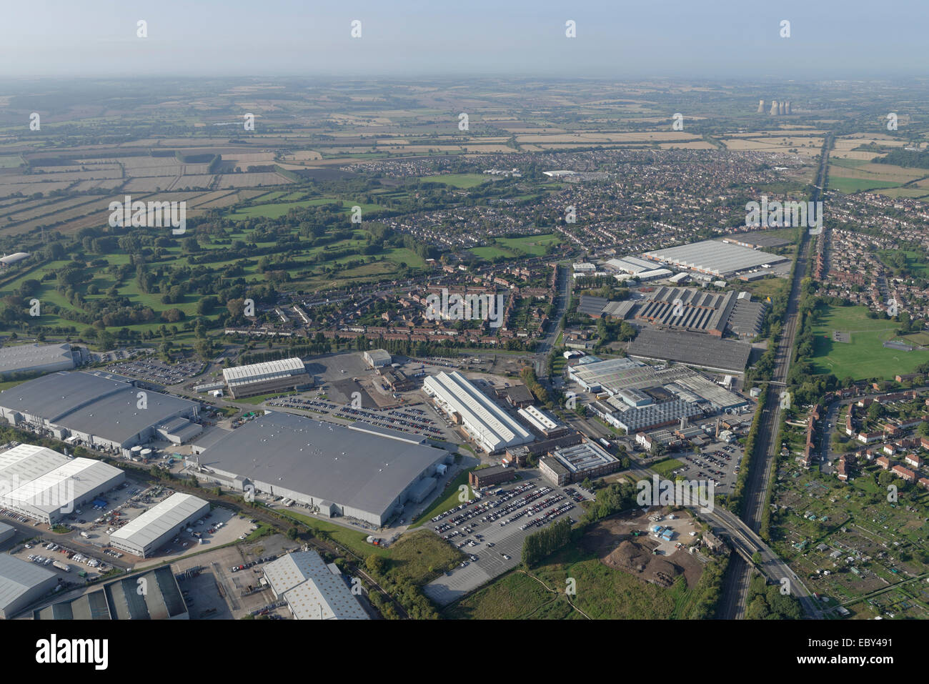 An aerial view of the Sinfin area of Derby showing a retail park, housing and a Rolls Royce factory - Stock Image