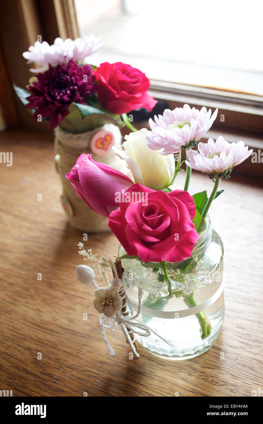 Pink Red And White Flowers In A Small Vase Stock Photo 76199024