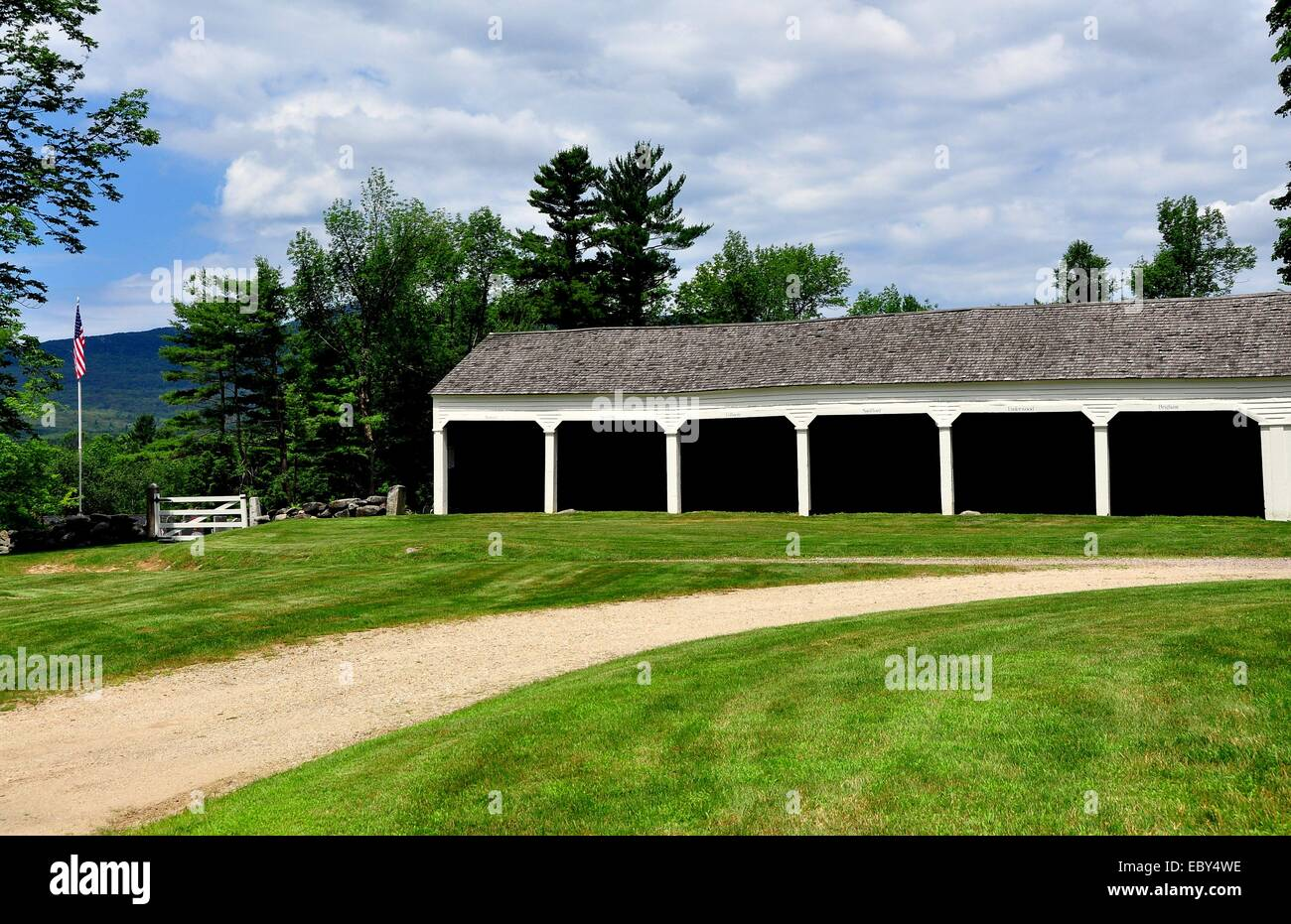 JAFFREY CENTER, NEW HAMPSHIRE:  A row of wooden stables for parishoner's horse carriages next to the 1775 Original - Stock Image