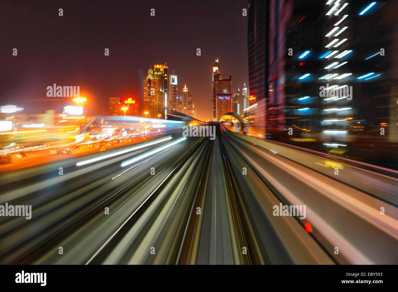 Dubai Metro by night - Stock Image