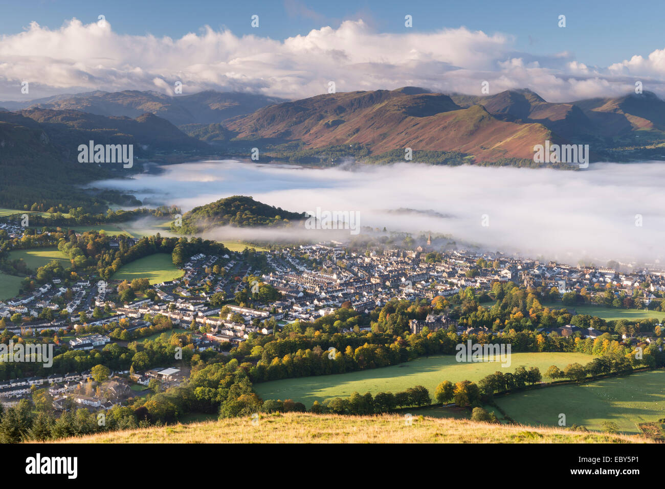 Keswick and mist covered Derwent Water at dawn, Lake District, Cumbria, England. Autumn (October) 2012. - Stock Image