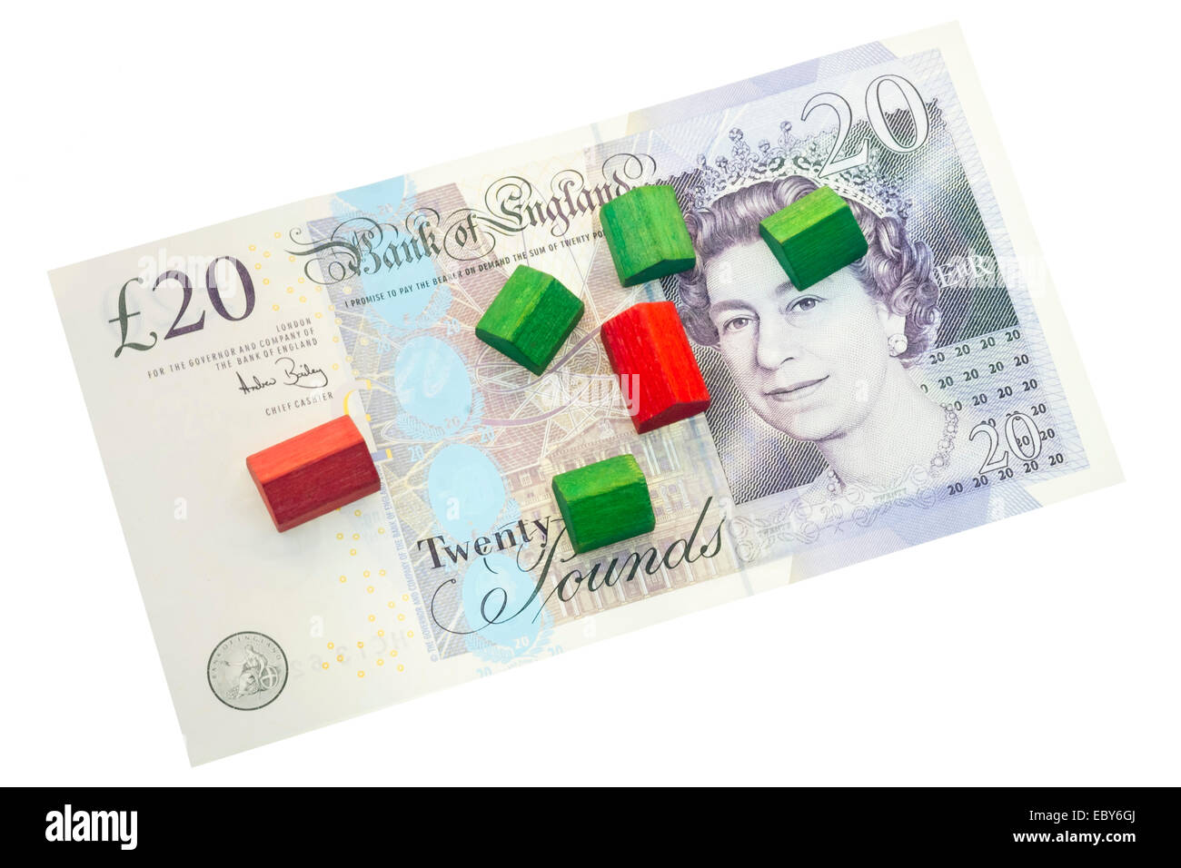 Toy houses on a twenty pound note. Concept for money & the housing market, stamp duty etc. - Stock Image