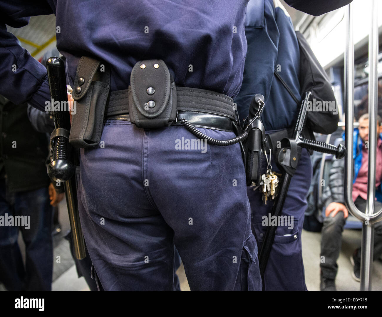 transport police train metro carriage baton gun - Stock Image