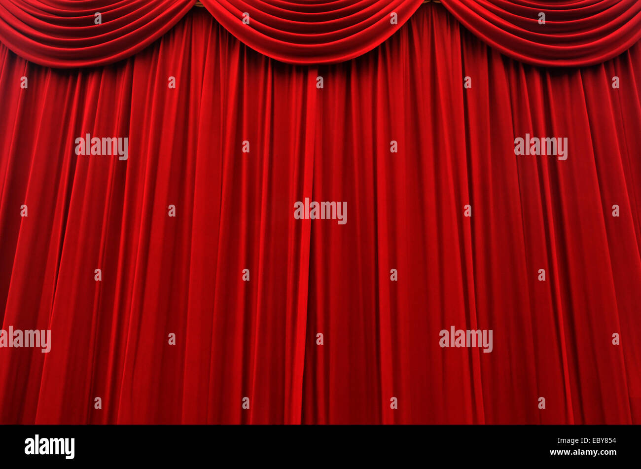 Red cinema and stage curtain background texture. - Stock Image