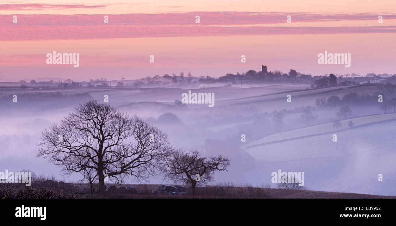 Mist shrouded countryside looking towards the village of Morchard Bishop, Devon, England. Winter (March) 2014. - Stock Image