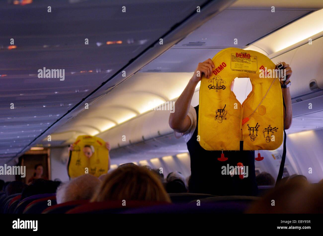 GOLD COAST, AUS - NOV 22 2014:Flight attendants during Pre-flight safety demonstration. - Stock Image