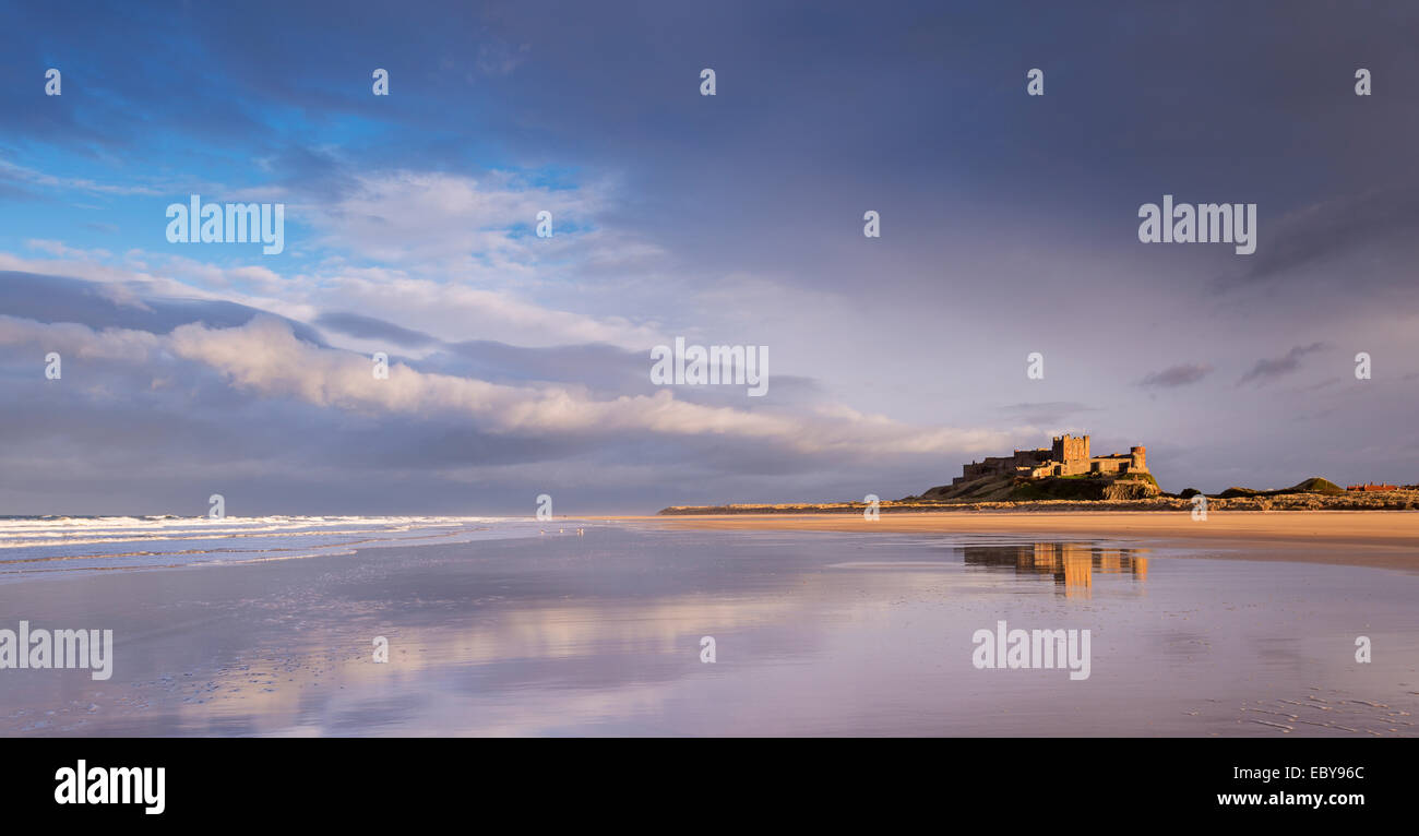 Bamburgh Castle and beautiful deserted beach, Northumberland, England. Winter (March) 2014. - Stock Image