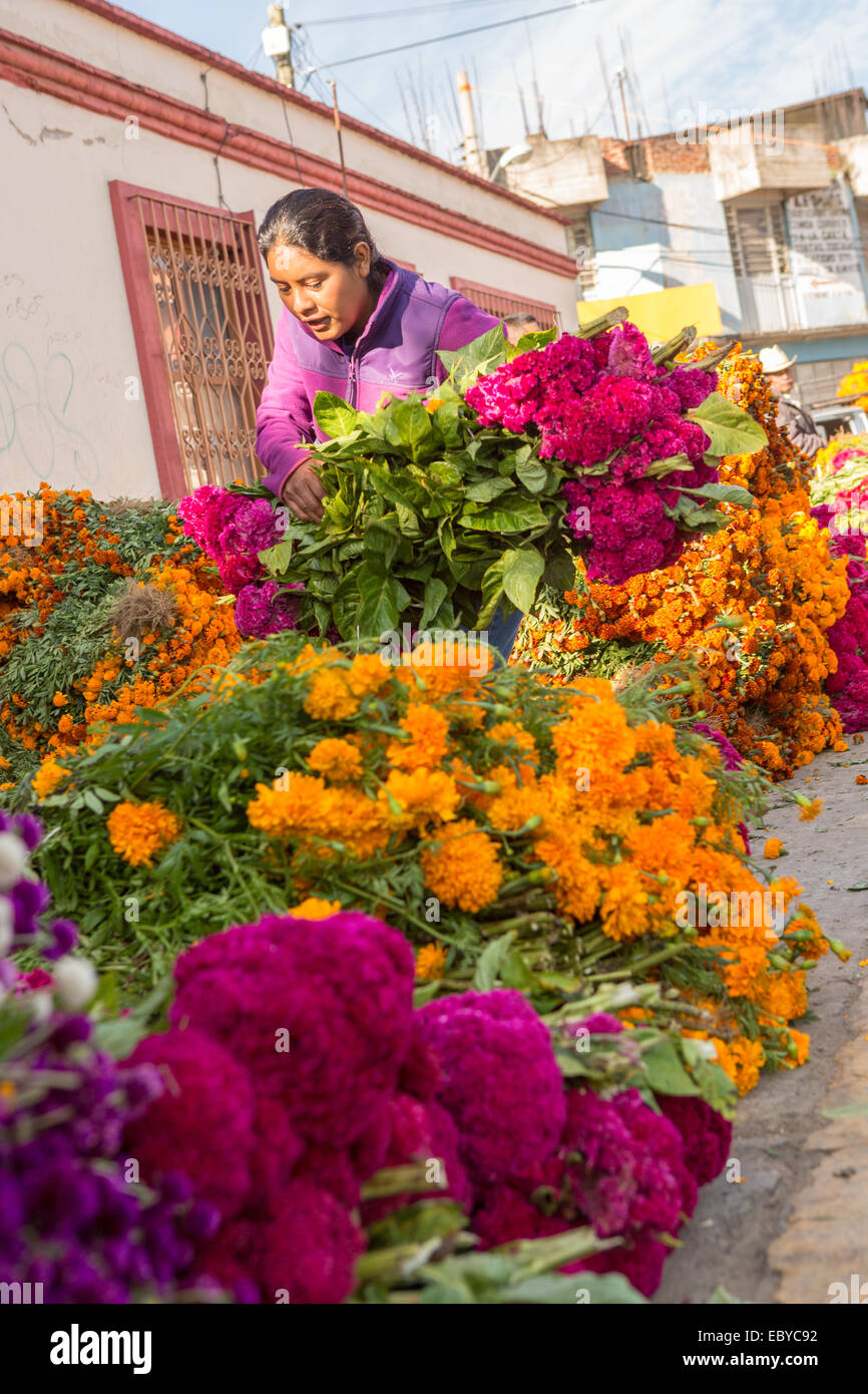 Vendors prepare massive piles of flowers use to decorate tombs for ...