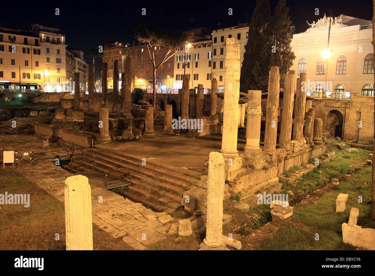 area sacra Roman ancient ruins in Largo di Torre Argentina square by Night, Rome, Italy - Stock Image