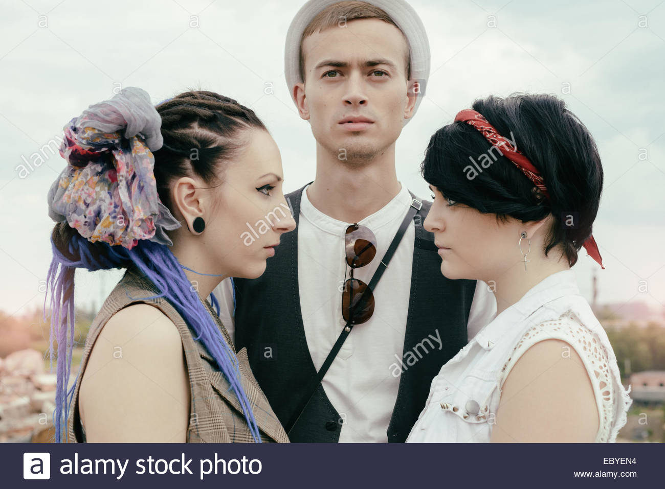 love triangle the young guy before a choice in resistance of two girls - Stock Image