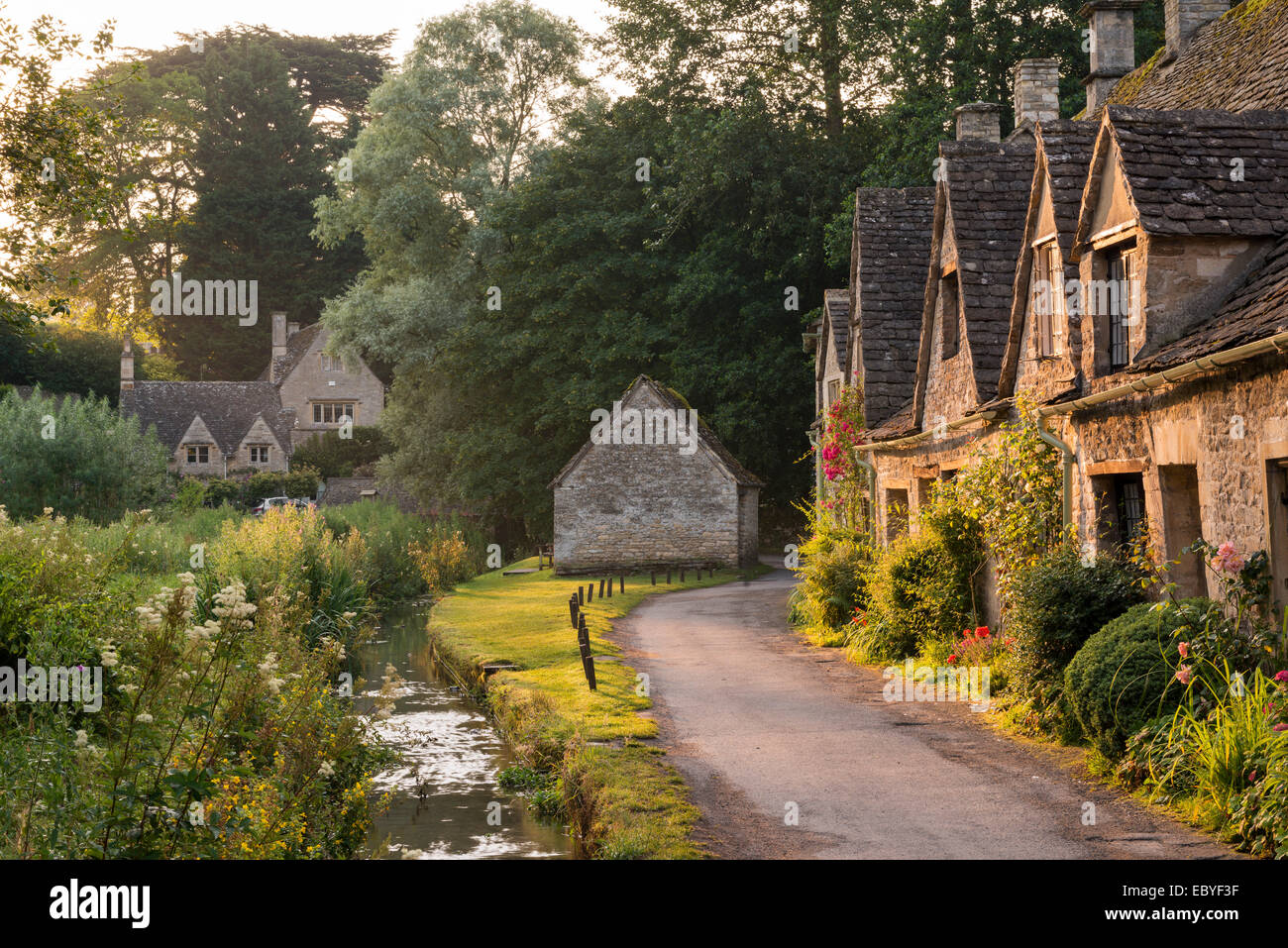Picturesque cottages at Arlington Row in the Cotswolds village of Bibury, Gloucestershire, England. Summer (July) - Stock Image