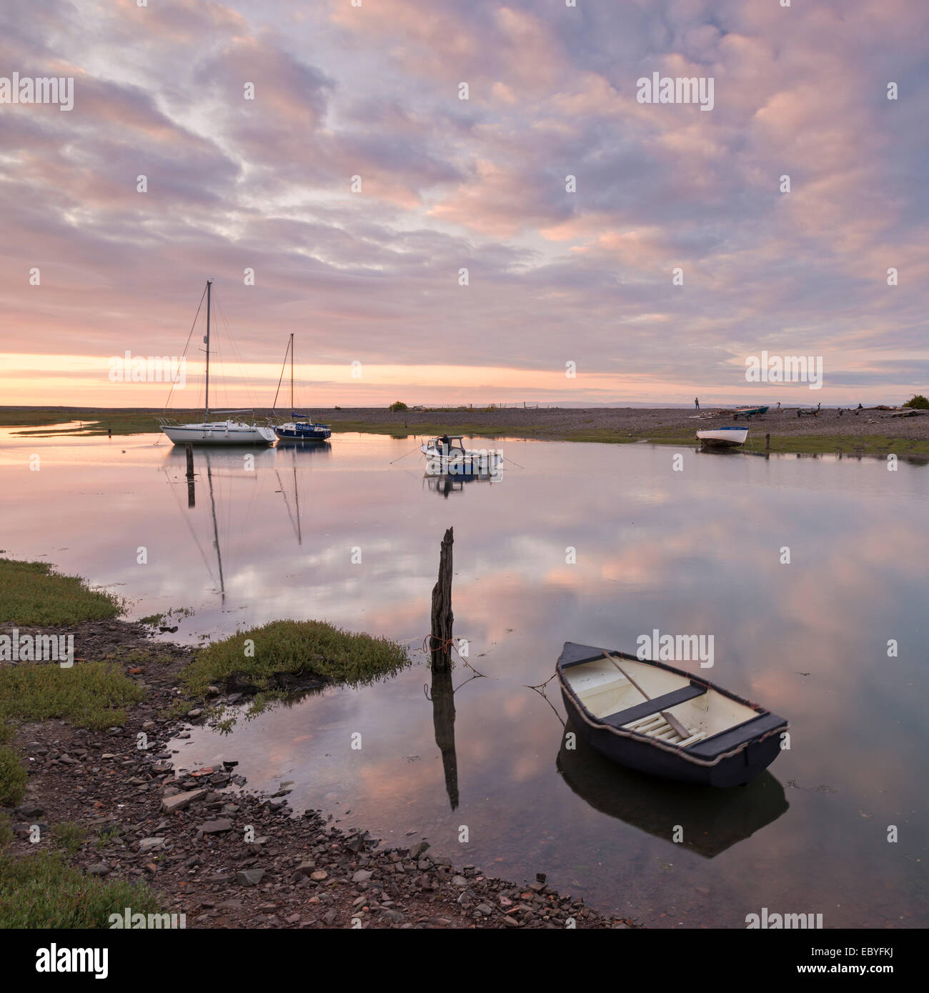 Boats in Porlock Weir at sunset, Exmoor, Somerset, England. Summer (July) 2014. - Stock Image