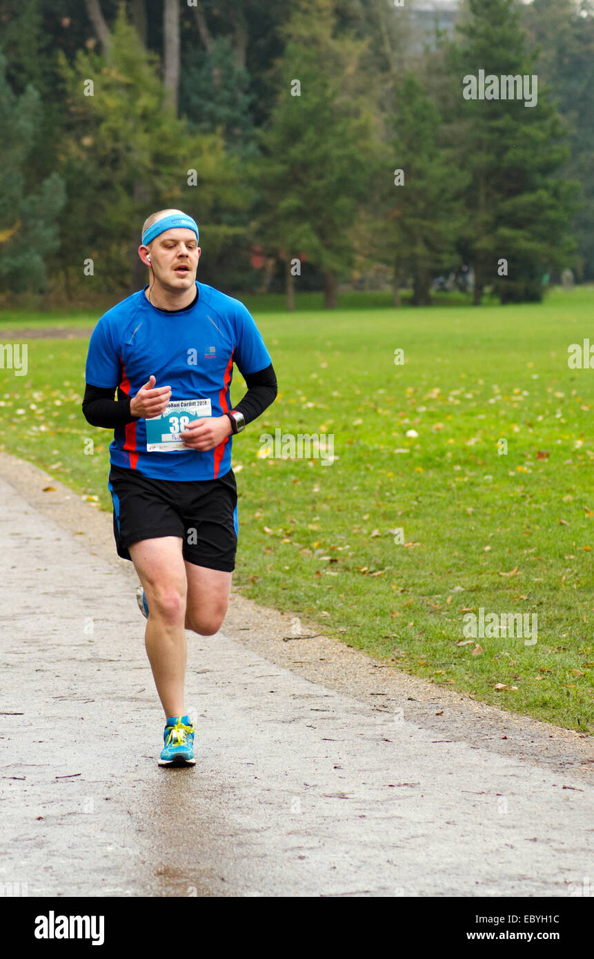 Runner at the Cardiff 5k Morun, Cardiff 2014, part of Movember mens health fundraising events - Stock Image
