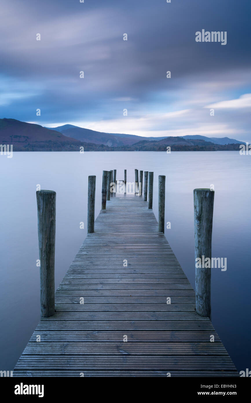Wooden jetty on Derwent Water in the Lake District, Cumbria, England. Autumn (November) 2014. - Stock Image