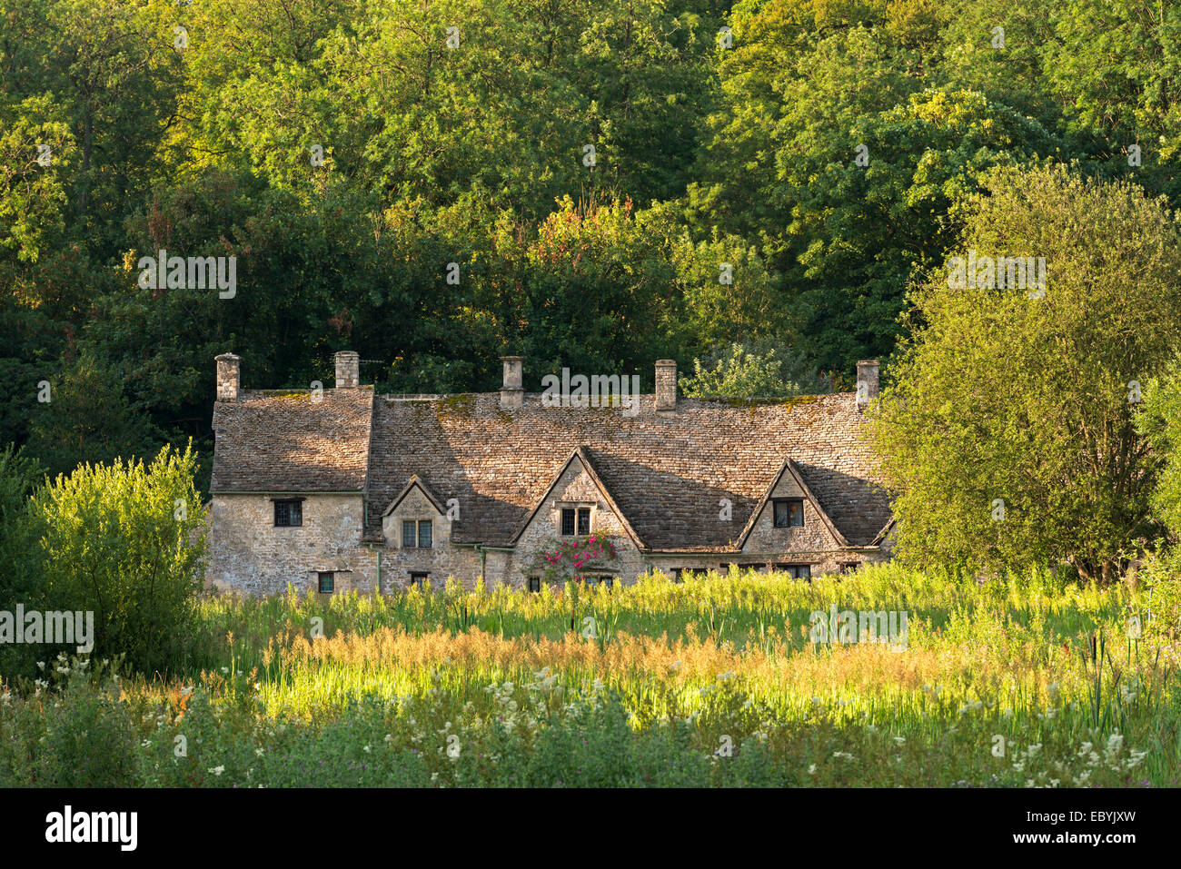 Arlington Row cottages in the Cotswold village of Bibury, Gloucestershire, England. Summer (July) 2014. - Stock Image