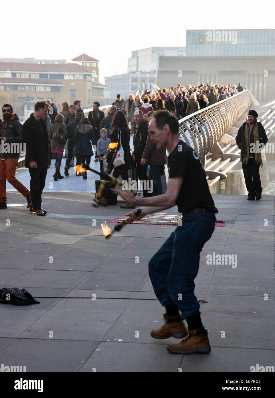 Street Busker entertainer playing with fire London - Stock Image