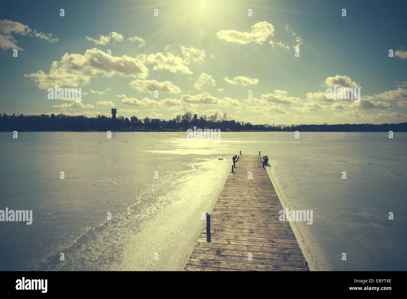 Vintage retro toned image of lake in winter. Stock Photo