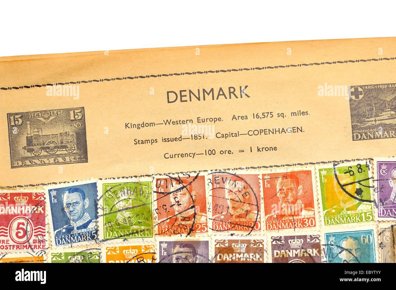 An old fully illustrated stamp album with stamps from Denmark Stock Photo