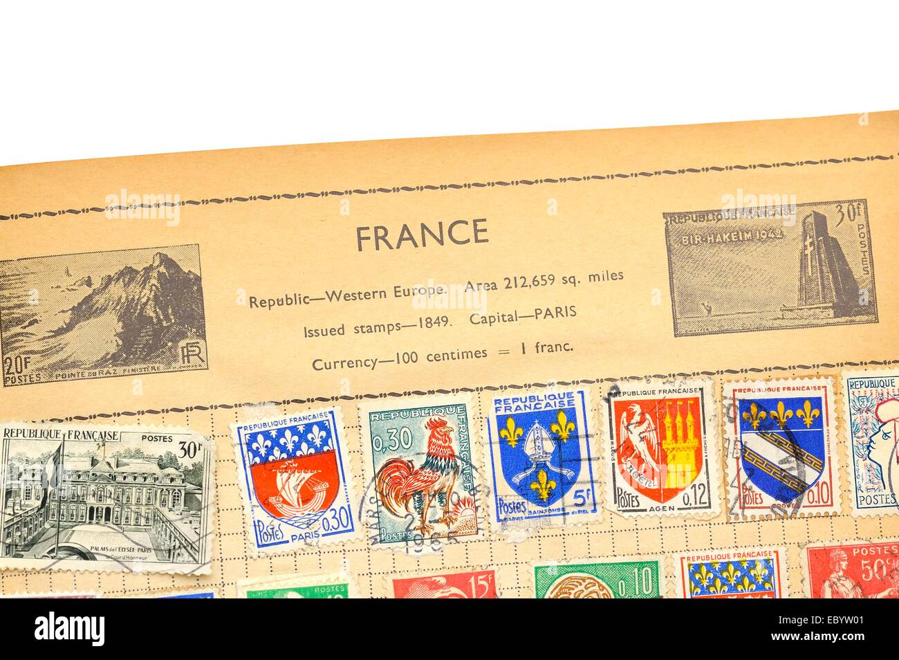 An old fully illustrated stamp album with stamps from France Stock Photo