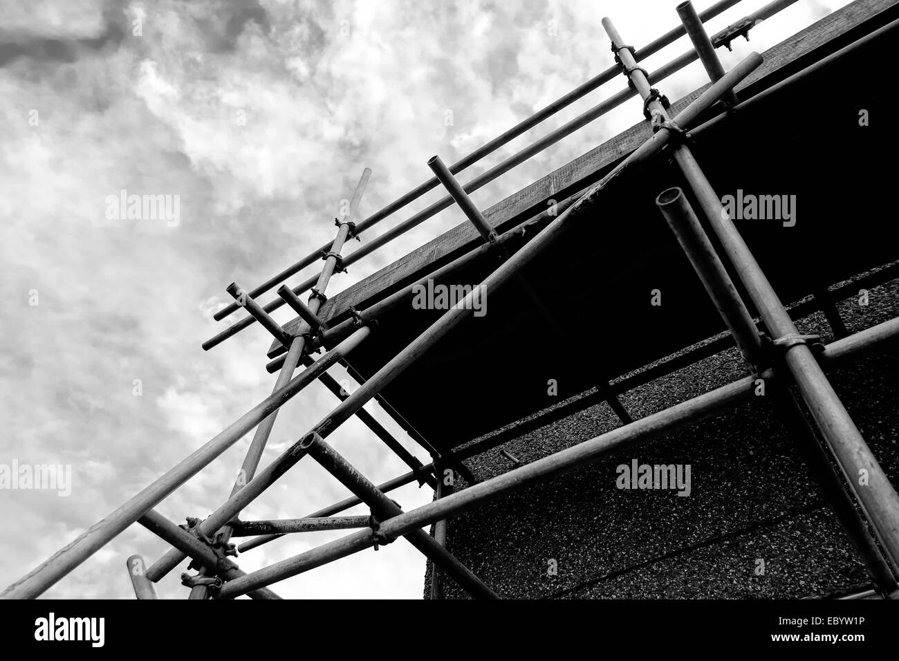 Scaffolding erected around a house in need of roof repairs England UK - Stock Image