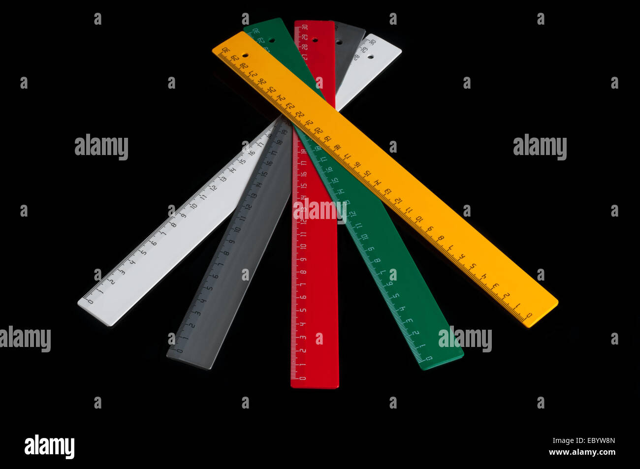 Set of colorful rulers isolated on black - Stock Image