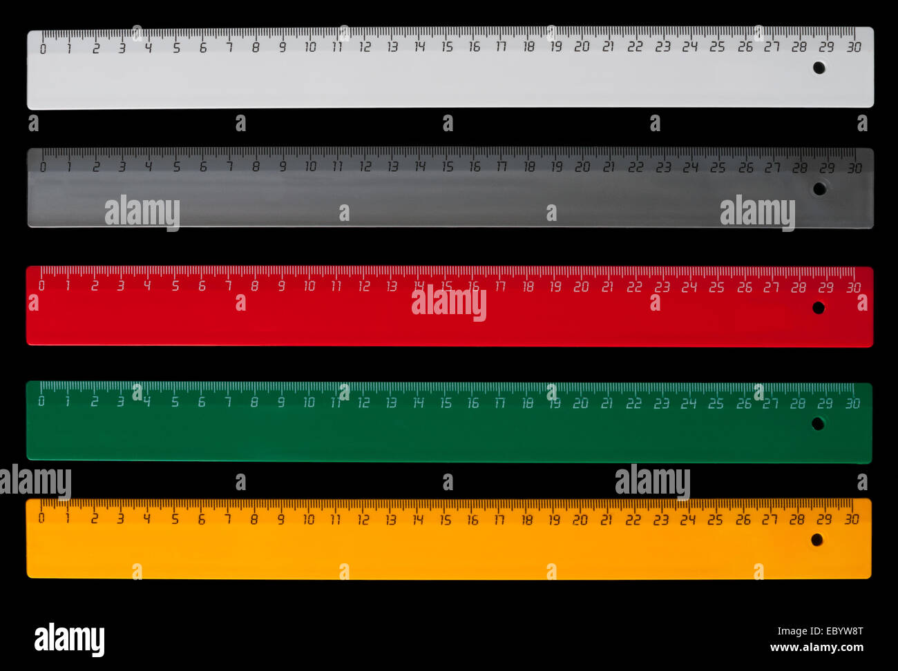 Five colorful centimeter rulers isolated on black background - Stock Image
