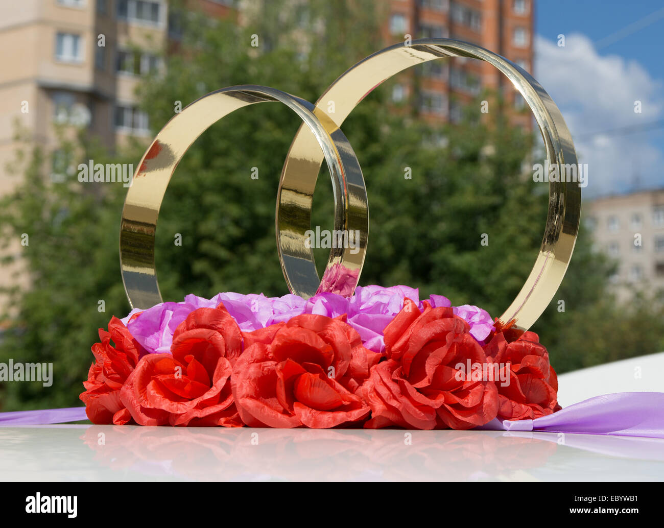 Two golden rings and artificial flowers as wedding car decoration two golden rings and artificial flowers as wedding car decoration junglespirit Gallery