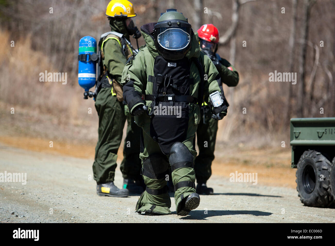 A US Marine Explosive Ordnance Disposal expert with the Chemical Biological Incident Response Force responds to - Stock Image