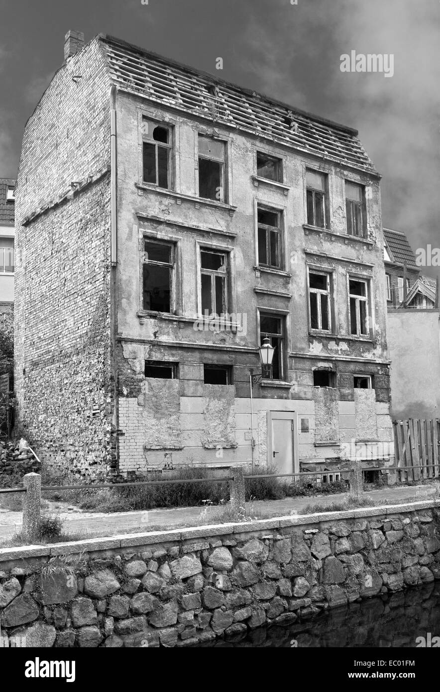 Black and white shot of a abandoned house in the old part of Wismar, Germany - Stock Image