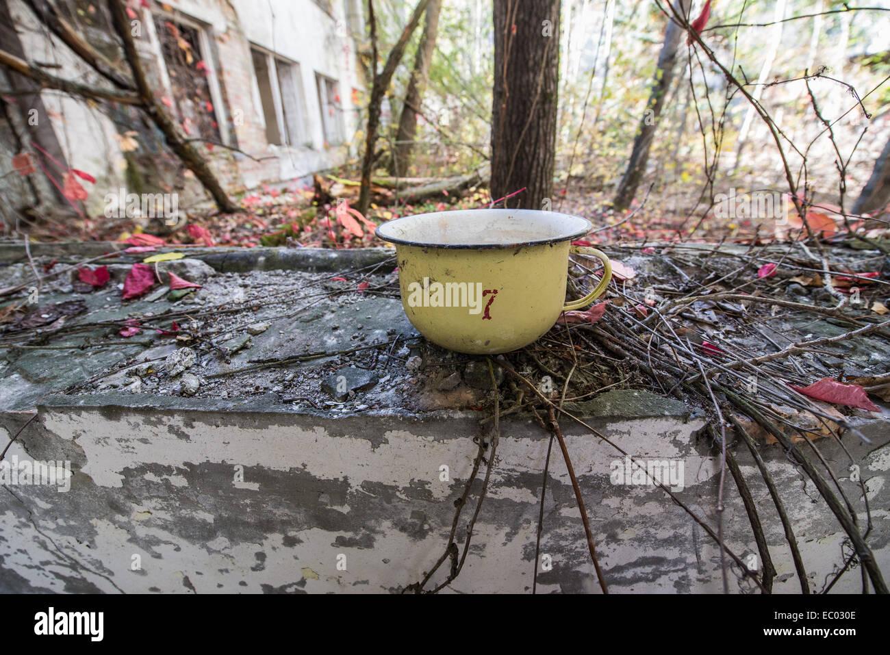 yellow metal potty in kindergarten 'Cheburashka' in Pripyat abandoned city, Chernobyl Exclusion Zone, Ukraine - Stock Image
