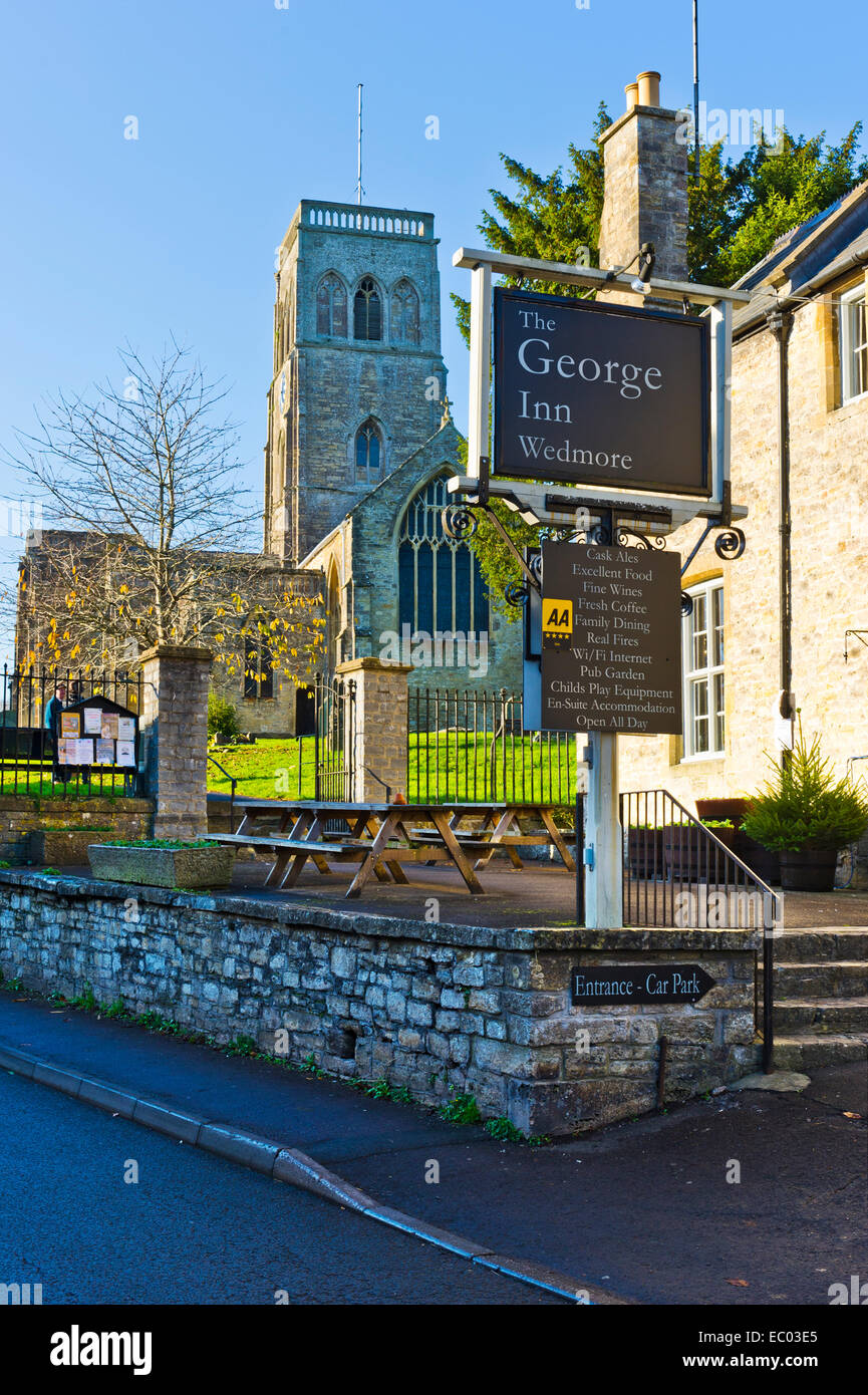 St Mary's Church and the George Hotel, in the village of Wedmore, Somerset, South West England. - Stock Image