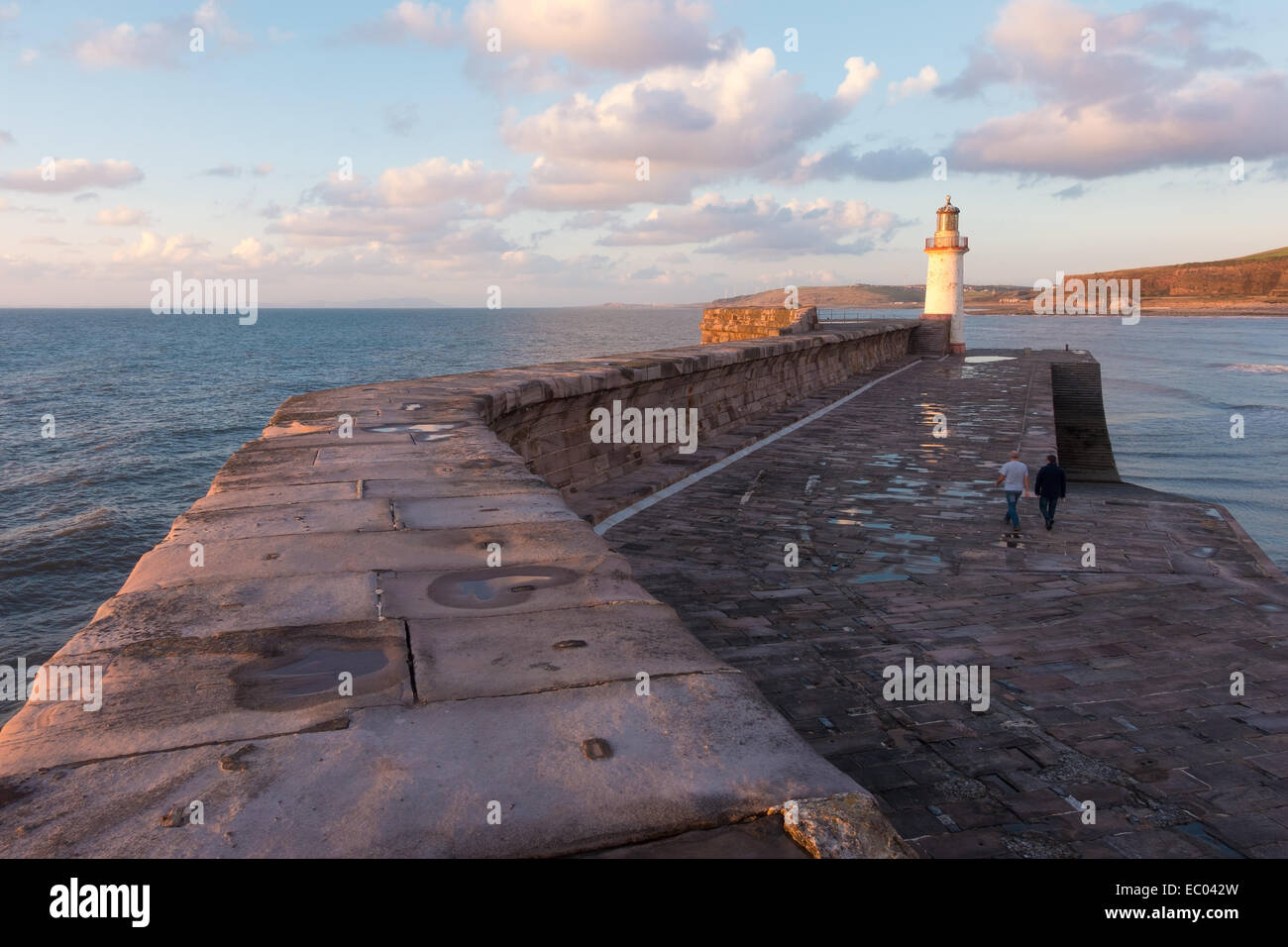 The breakwater and lighthouse at the harbour at Whitehaven, Cumbria. - Stock Image