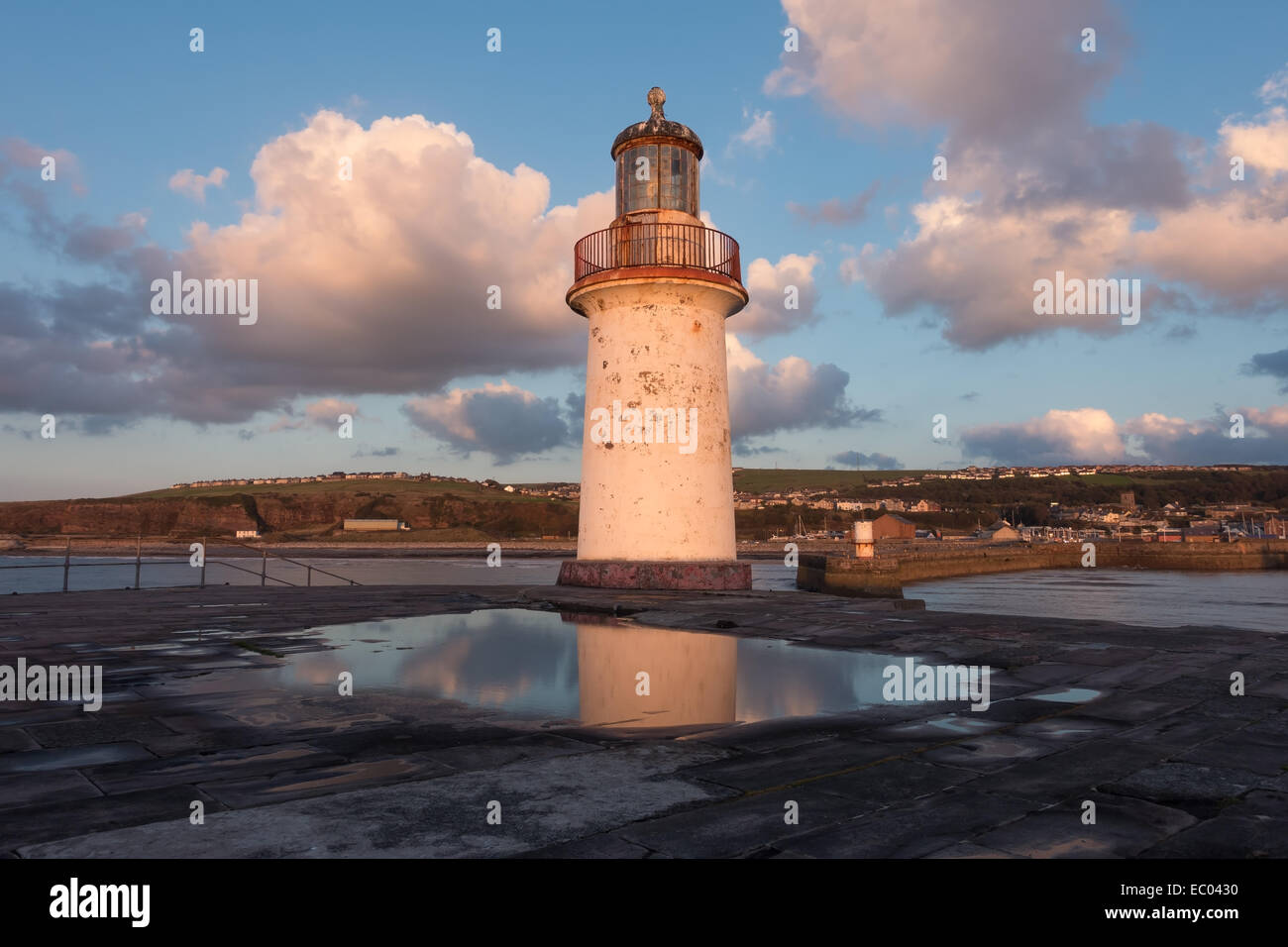 The lighthouse at the end of the breakwater at Whitehaven, Cumbria. - Stock Image