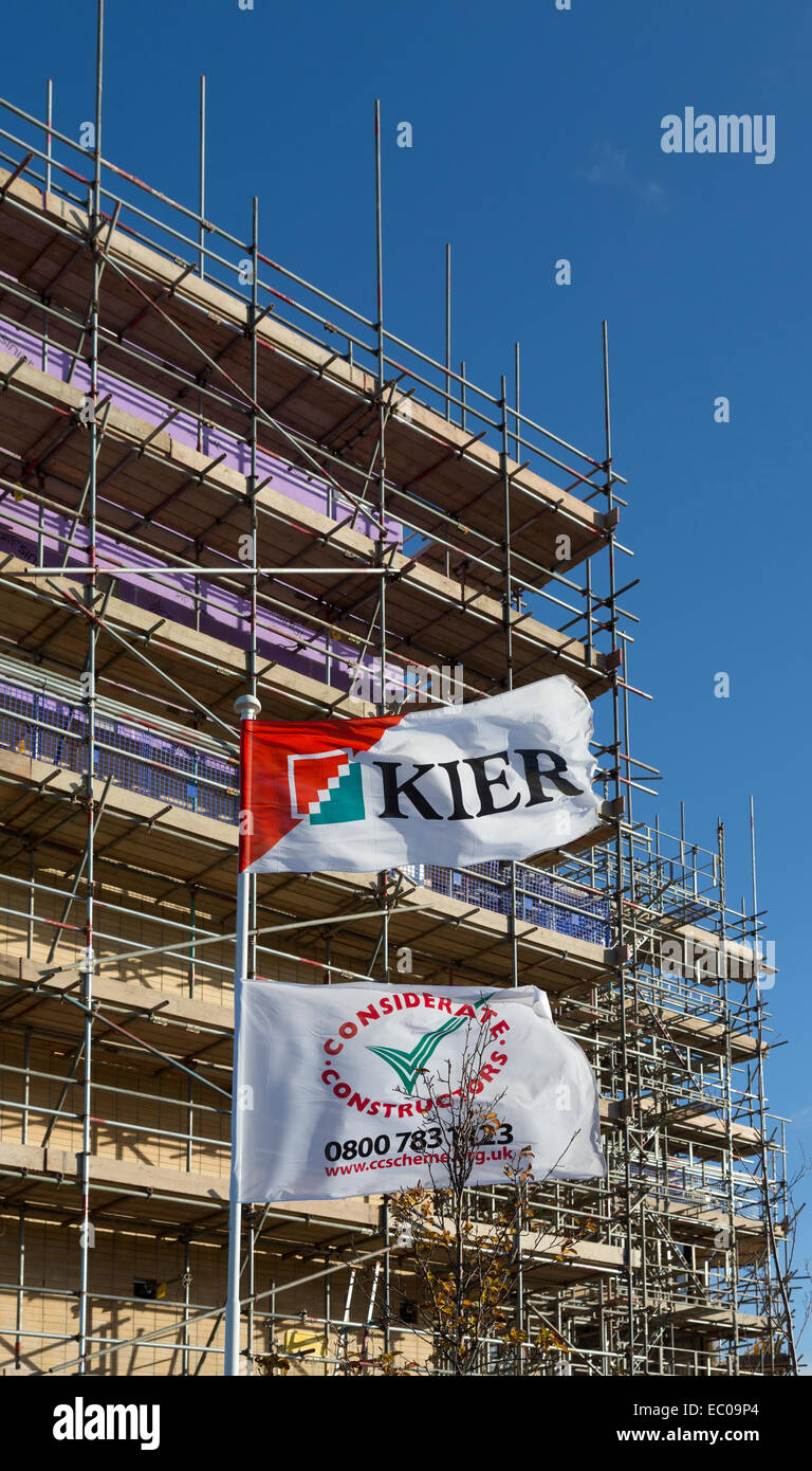 Kier construction flag and scaffolding on building project, Cardiff Bay, Wales, UK - Stock Image