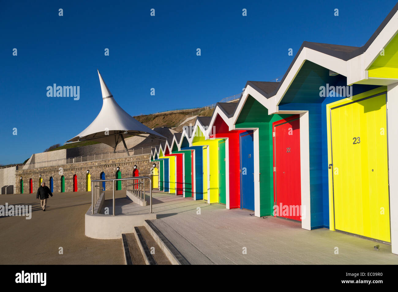Brightly coloured beach huts, Barry Island, Wales, UK Stock Photo