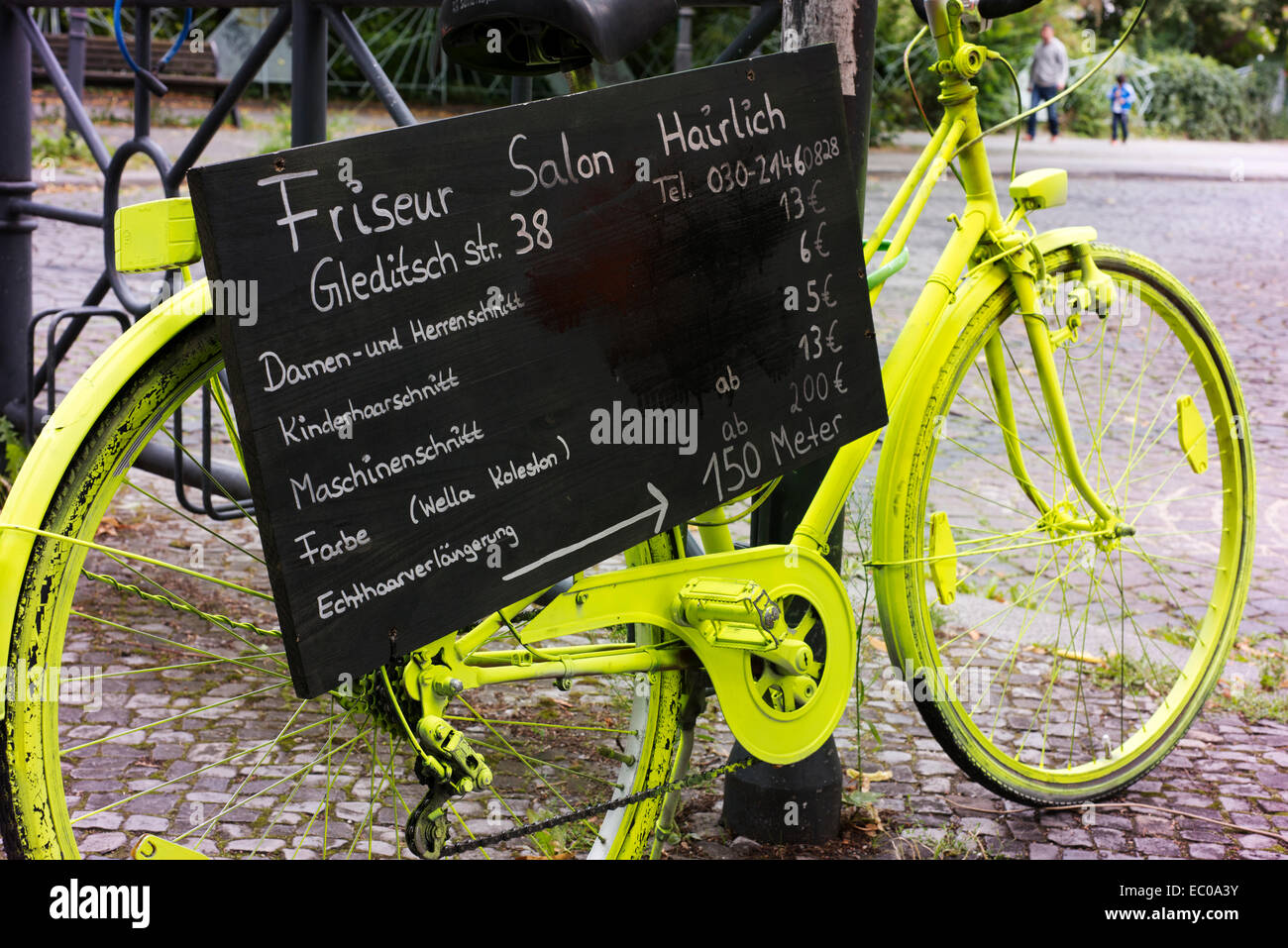 Luminescent paint on a bike used as part of a promotion for a Berlin hairdresser. - Stock Image