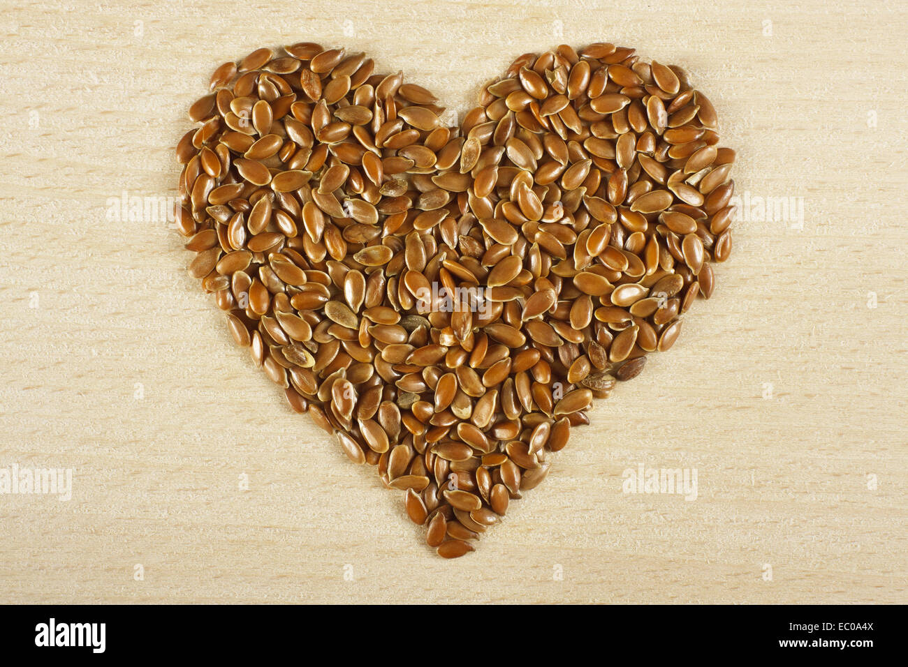 Heart  shape made from flax seed - Stock Image