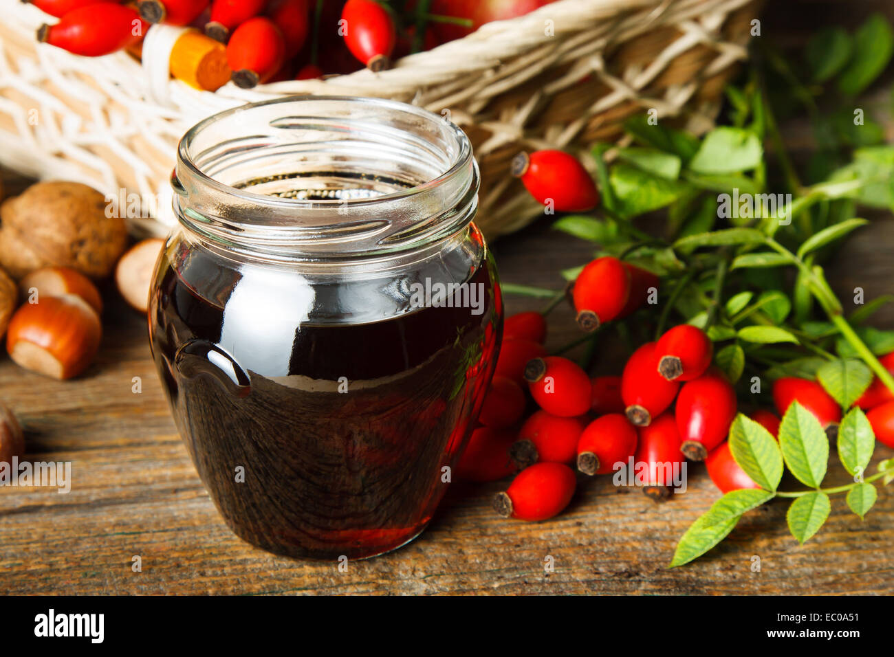 The thick syrup made from rose hips - Stock Image