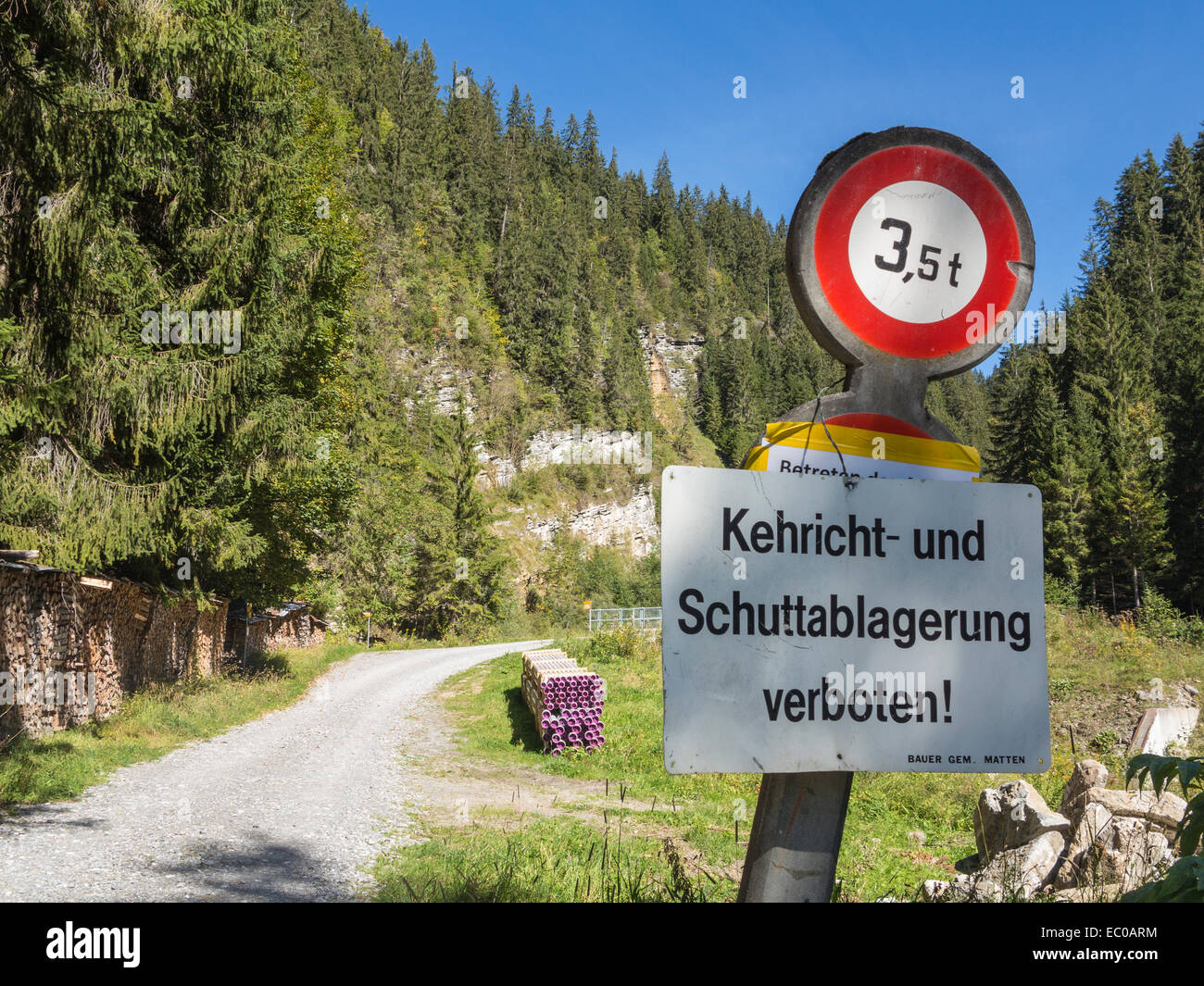 A sign, in German forbidding dumping on a mountain track (exact translation reads 'Rubbish and debris deposition - Stock Image