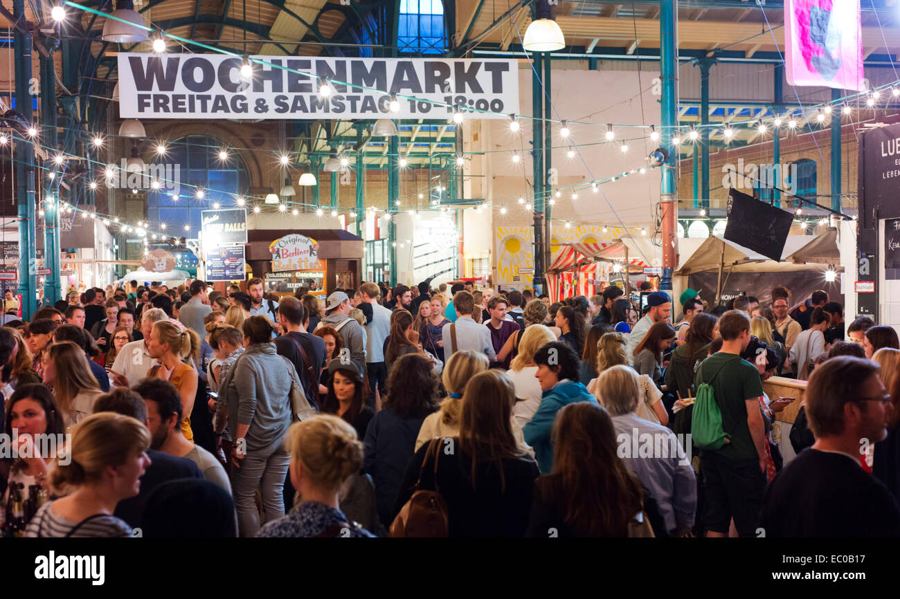 Crowds at Kreuzberg's Markthalle Neun, a place for casual dining and socializing. - Stock Image
