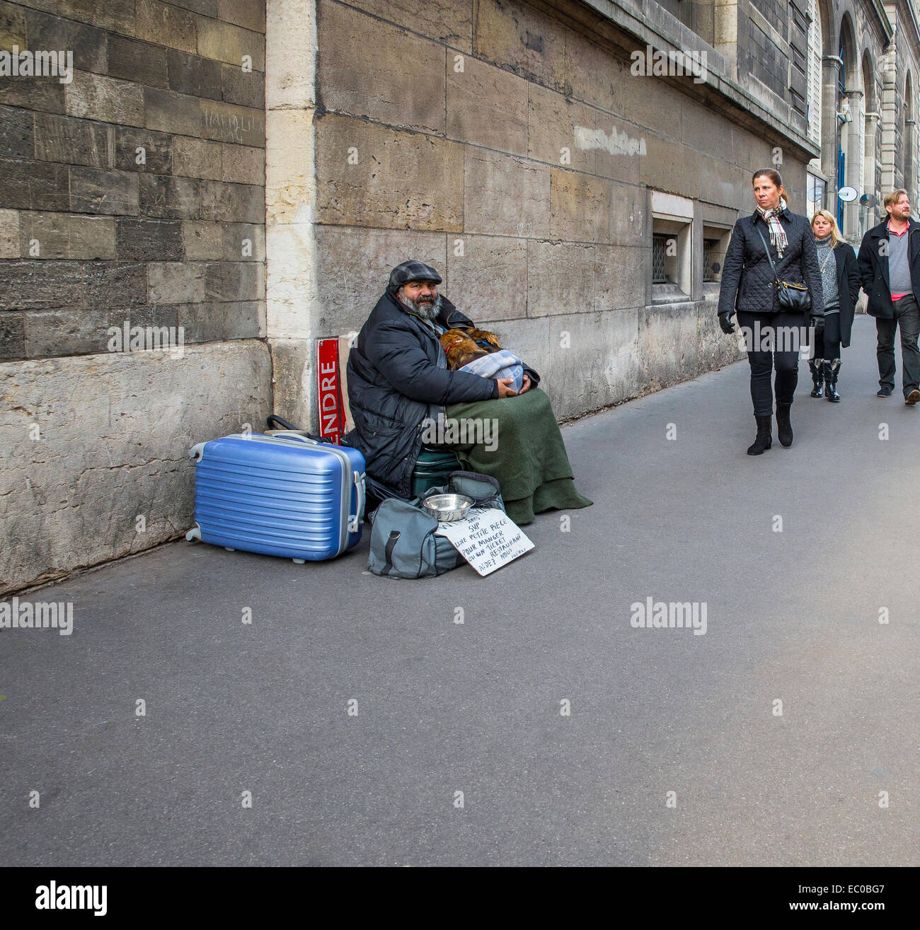 homeless man begging street beggar passers by - Stock Image
