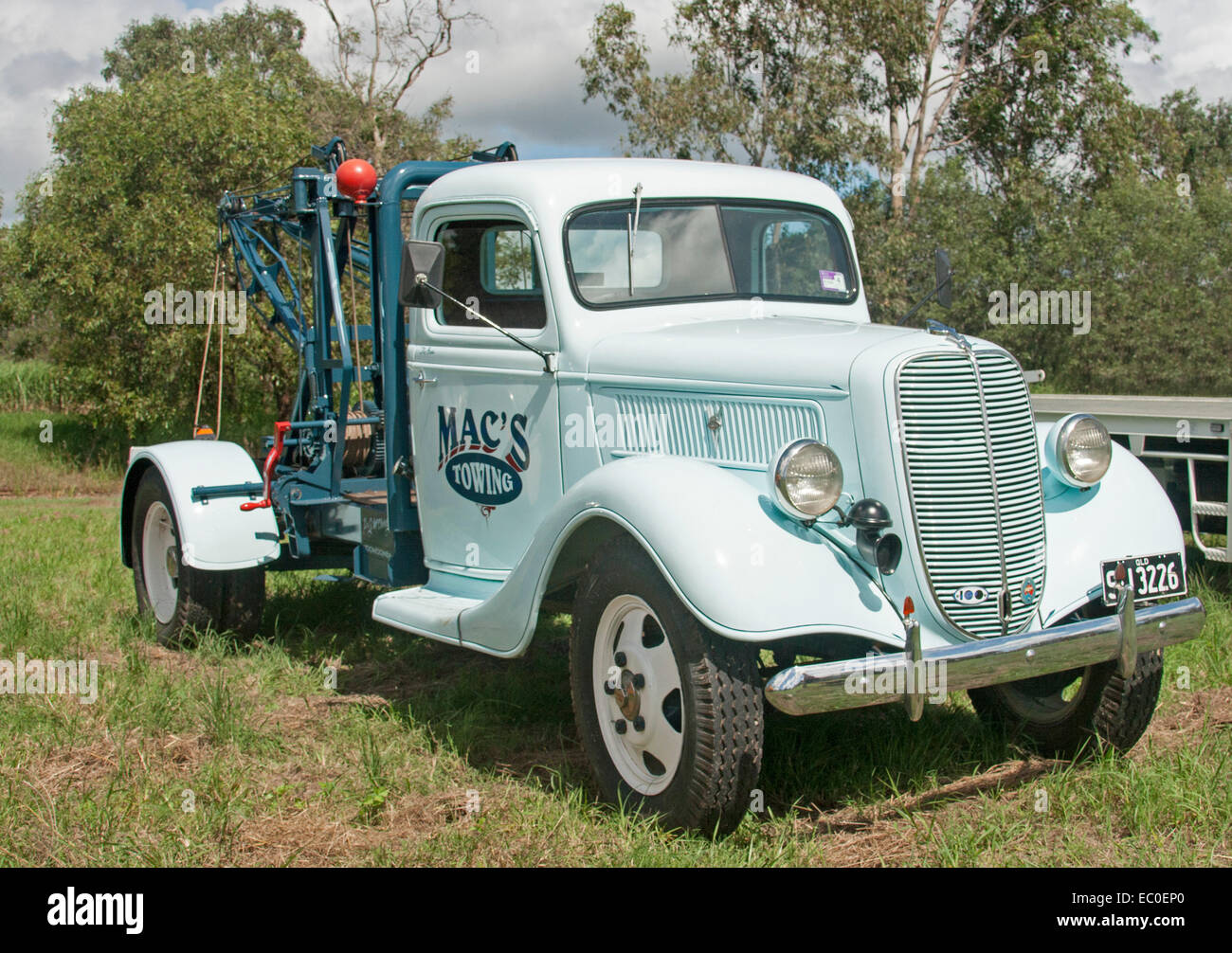 Pale blue restored vintage tow truck with winch and other equipment in working condition - Stock Image