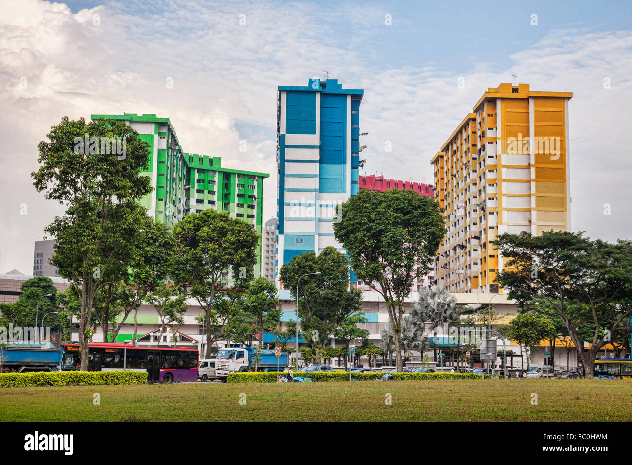 Colourful apartment buildings in a busy Singapore Street. - Stock Image