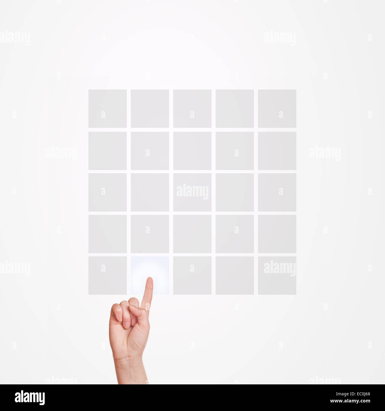 Caucasian female hand pressing 5x5 matrix touchscreen button with index finger. - Stock Image